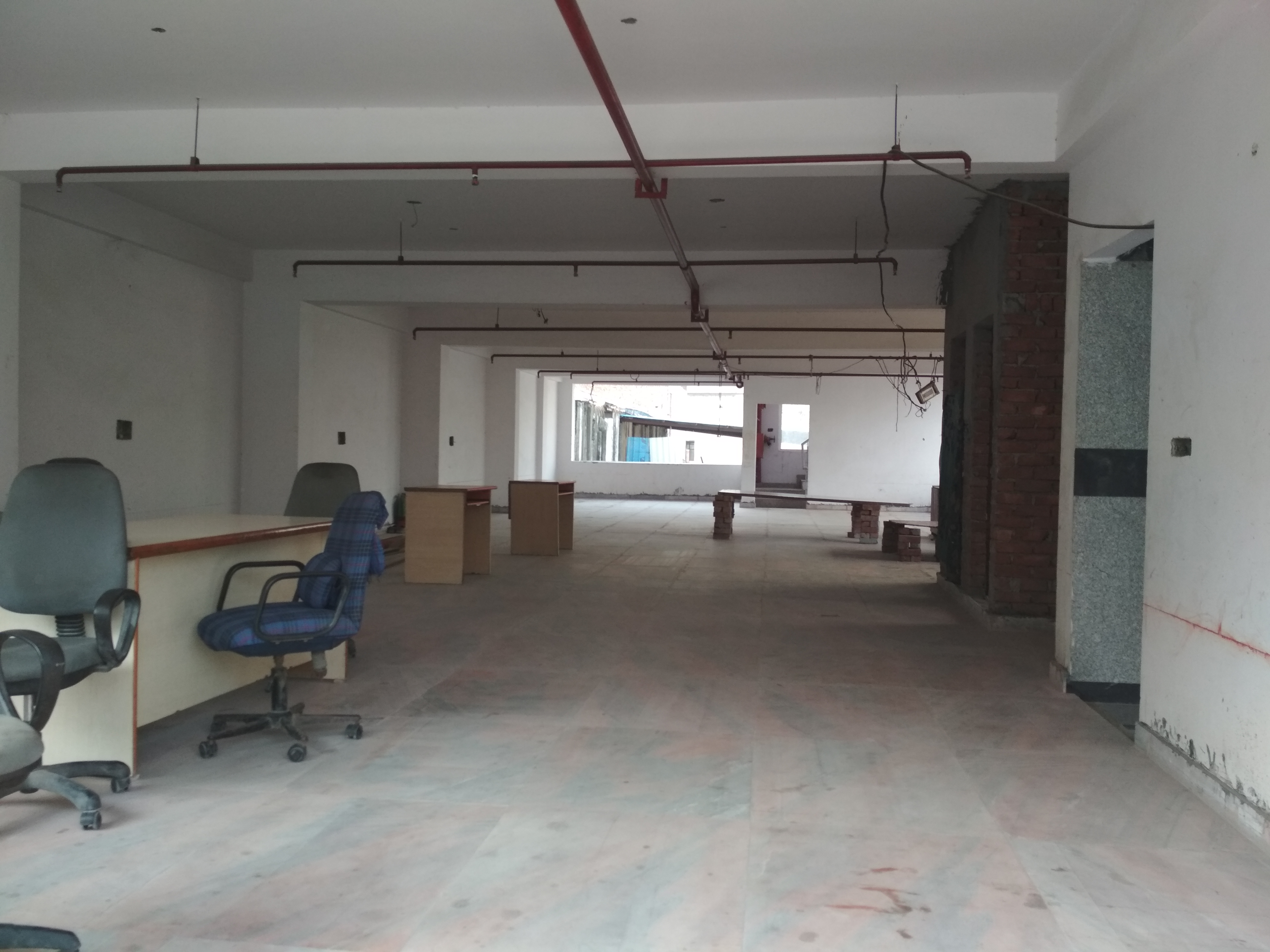 Bare Shell Office space with complete Flooring